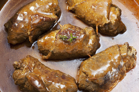 interiour shots: Beef roulades with sauce in pot