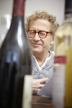 Senior man testing red and white wine