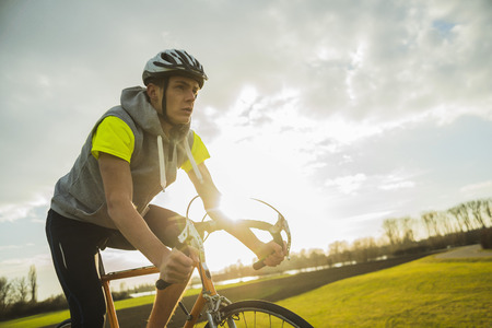 motivations: Germany, Mannheim, young man riding bicycle