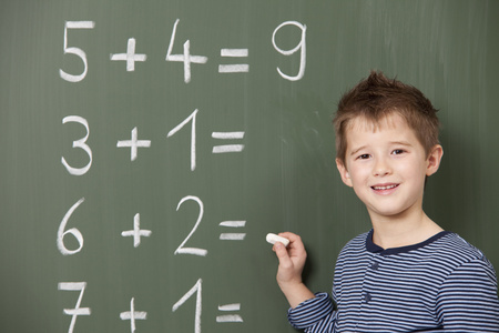 figuring: Schoolboy at blackboard with arithmetic problems
