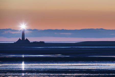 dwelling mound: Germany, North Frisia, Westerhever, lighthouse at dusk LANG_EVOIMAGES