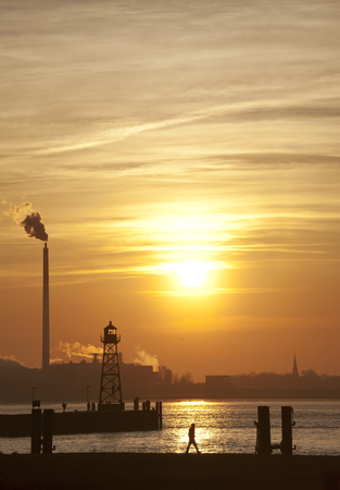 dikes: Germany, Bremerhaven, Lighthouse on the pier at sunset