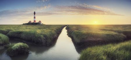 dwelling mound: Germany, North Frisia, Westerhever, lighthouse at sunset