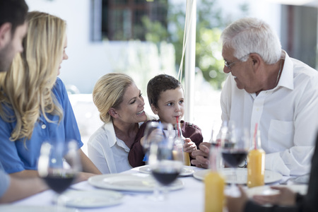 well laid: Mother, son and grandfather at family celebration