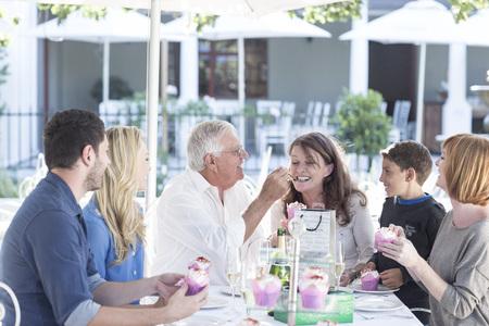 well laid: Three generations family celebrating grandfathers birthday at restaurant