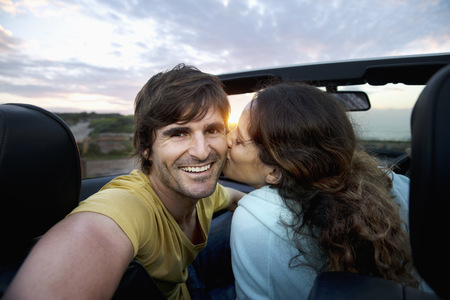 africa kiss: South Africa, happy couple in convertible at the coast at sunrise