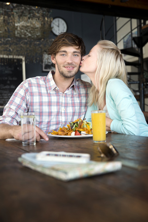 africa kiss: Young couple in a restaurant having lunch