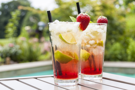 interiour shots: Strawberry Caipirinha with fresh mint and strawberry in glasses