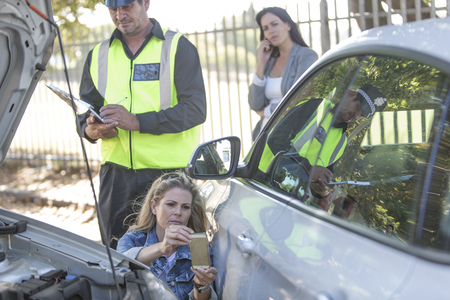 collisions: Woman and policeman at car accident scene