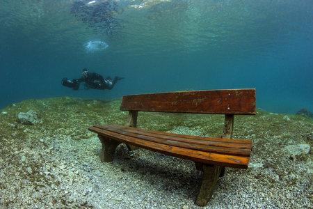 steiermark: Austria, Styria, Tragoess, lake Gruener See, diver and flooded park bench