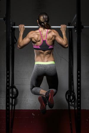 motivations: CrossFit athlete doing chin-ups