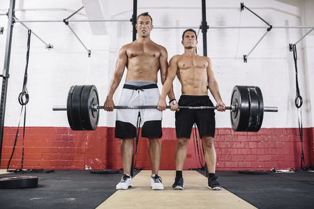 motivations: Two CrossFit athletes doing deadlift together