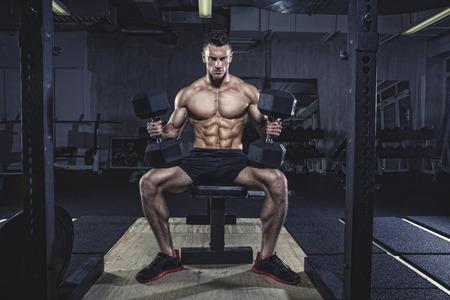 motivations: Physical athlete doing dumbbell bench presses