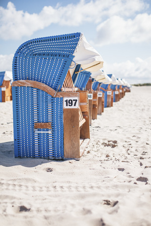 conformance: Germany, Warnemuende, hooded beach chairs on the beach