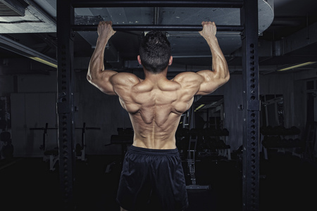 motivations: Physical athlete doing chin-ups