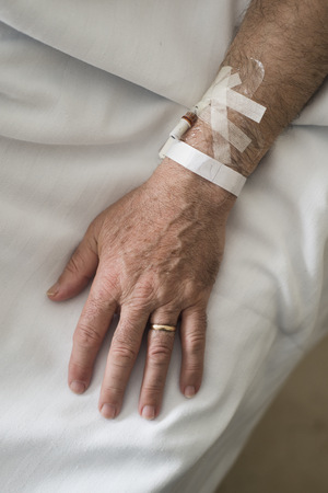 Hand of a married man convalescing in hospital