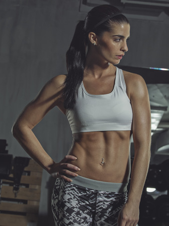 Portrait of a female athlete in gym