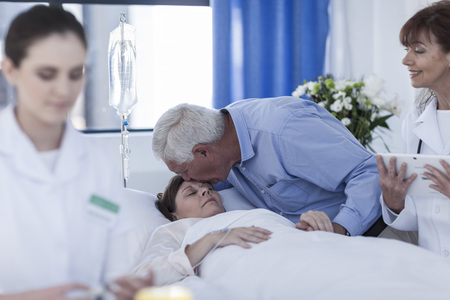 critical care: Senior man visiting wife in hospital LANG_EVOIMAGES