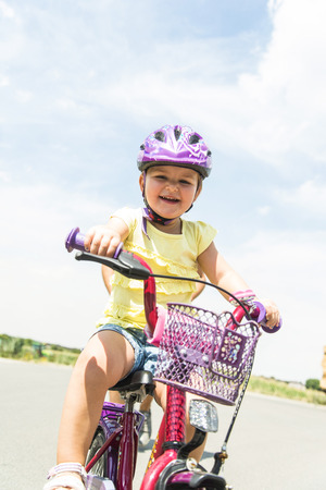 road bike: Happy little girl riding bike