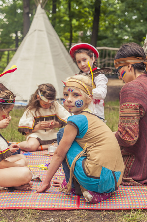 cowering: Germany, Saxony, Indians and cowboy party, Girls tinkering with beads
