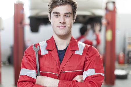 Car mechanic at work in repair garage LANG_EVOIMAGES