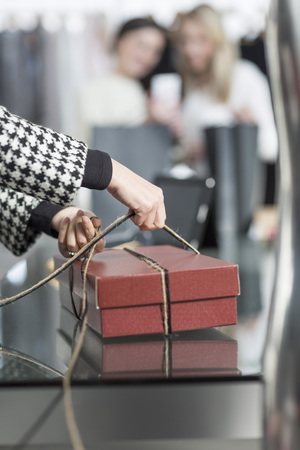 selling service: Shop assistant wrapping a box