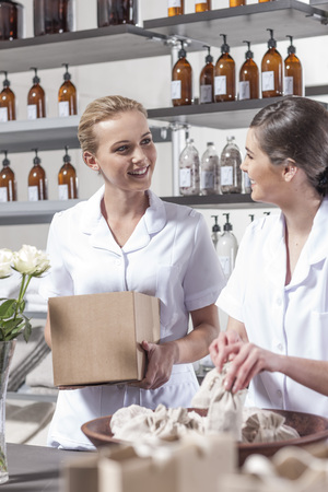 selling service: Two shop assistants working in wellness shop LANG_EVOIMAGES