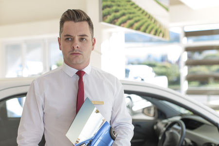 selling service: Car dealer in showroom
