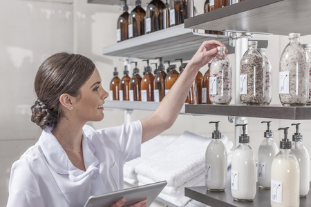 stocktaking: Shop assistant in wellness shop checking the stock LANG_EVOIMAGES