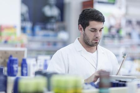 stocktaking: Pharmacist taking stock at drugstore