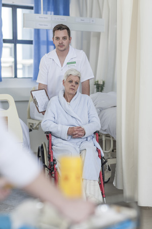 Nurse with elderly female patient in wheelchair LANG_EVOIMAGES