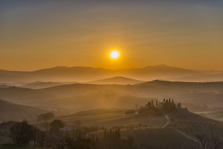 sunrises: Italy, Tuscany, San Quirico dOrcia, view to rolling landscape at sunrise
