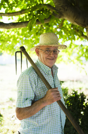 likeable: Spain, Ferrol, portrait of a farmer with hatchet on his shoulder