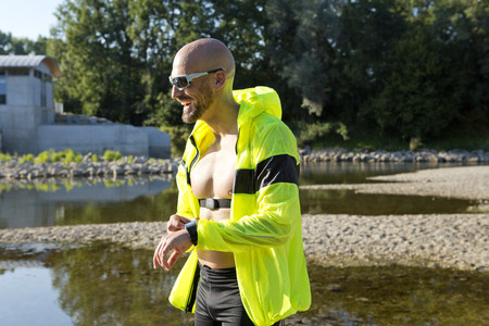 self testing: Confident man in sports wear adjusting his smartwatch