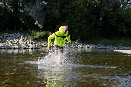 ambitious: Man in sports wear running in water LANG_EVOIMAGES