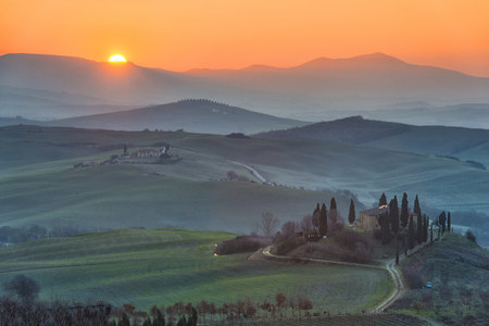 Italy, Tuscany, Val dOrcia, view to rolling landscape at sunrise