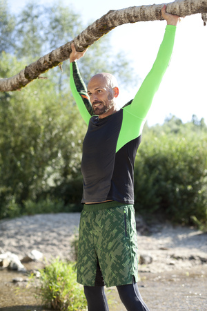 stemming: Man doing crossfit exercise with tree trunk