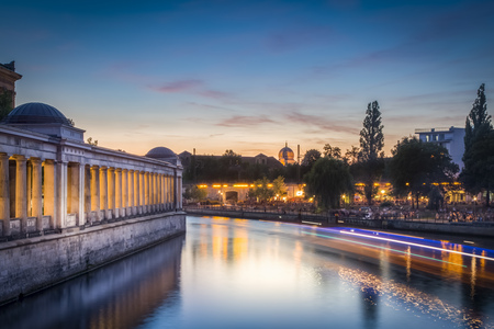 incidental people: Germany, Berlin, Spree river, Alte Nationalgalerie and New Synagoge aduring sunset