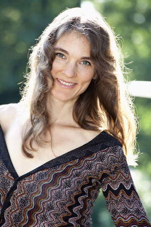 Portrait of smiling woman with long brown hair