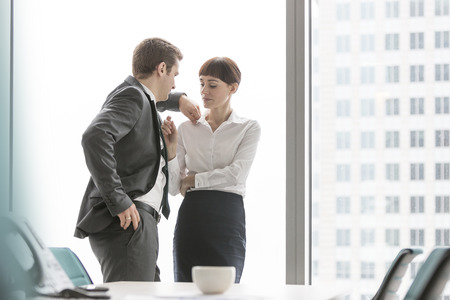 harassing: Businessman harassing businesswoman in office