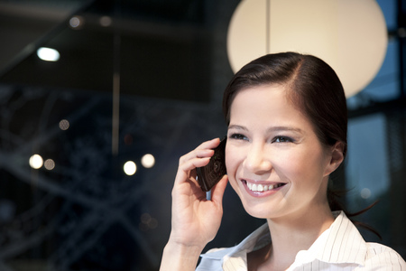 Smiling young businesswoman on the phone