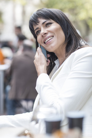 incidental people: Smiling woman on cell phone LANG_EVOIMAGES