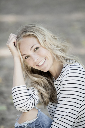 likeable: Portrait of smiling blond woman