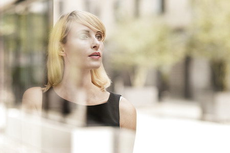 Portrait of businesswoman waiting LANG_EVOIMAGES