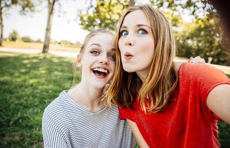 ardor: Two playful teenage girls taking a selfie