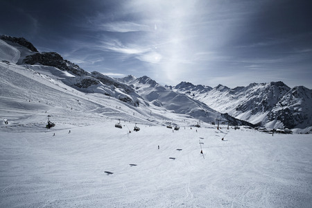 mountaintops: Austria, Tyrol, Ischgl, chair lift in winter landscape in the mountains