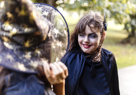 Portrait of masquerade girl at Halloween having fun with her friend