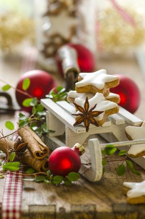 Christmas decoration with miniature sledge and cinnamon stars