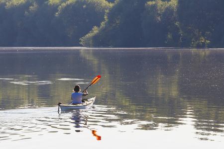 Germany, Stuttgart, woman kayaking on Max-Eyth-See