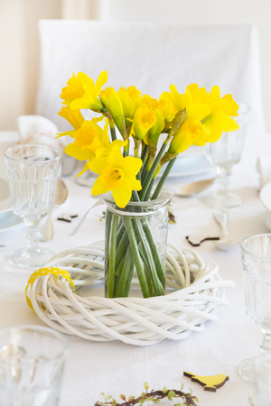Laid table with daffodils at springtime